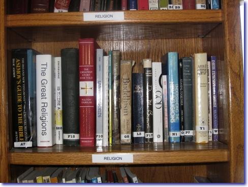 Religious books on a bookshelf